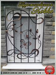 Кованые оконные решетки,  решетки на окна с коваными элементами,  ручная